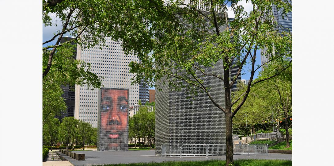 A fountain in downtown chicago projects local residences' faces on a screen.
